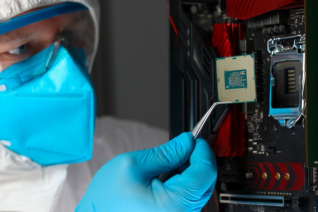 Male engineer install microprocessor in fast computer