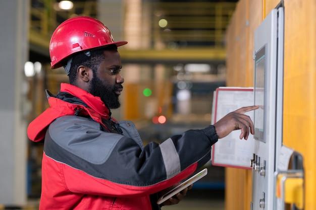 Male engineer setting up equipment