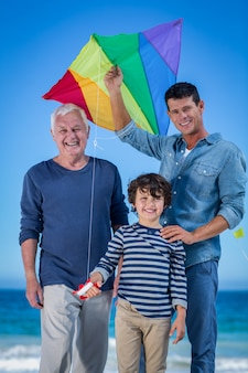 Male family members playing with a kite