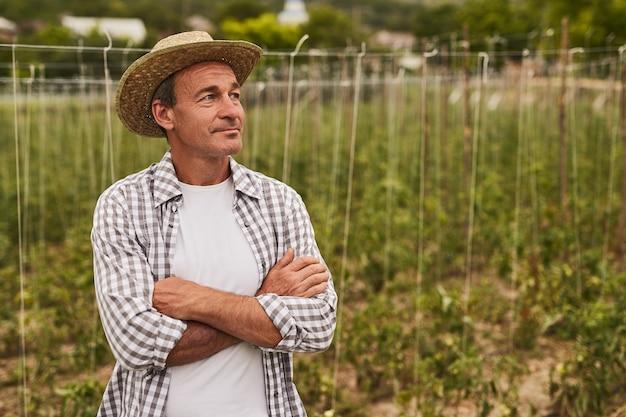 Male farmer in field in countryside