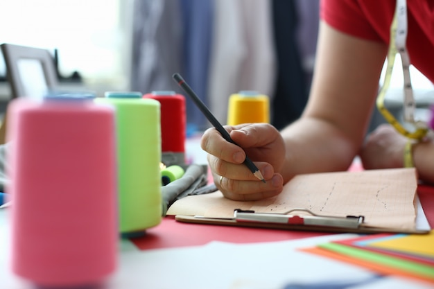 Male fashion designer is working in studio