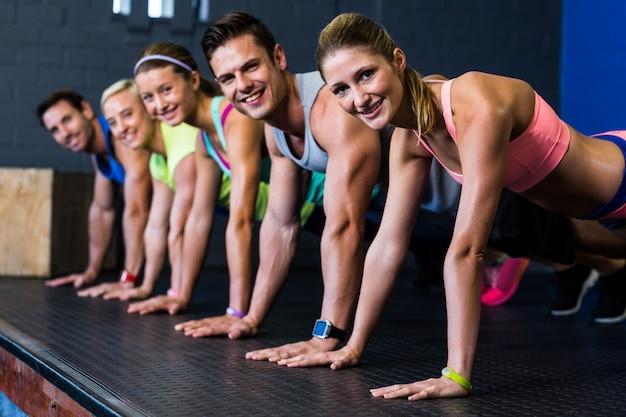 Male and female athletes doing push-ups