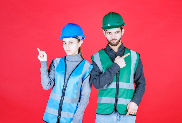Male and female engineers wearing helmet and gear showing left or right side.