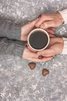 Male and female hands holding cups of coffee. selective focus.