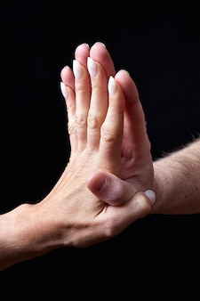 Male and female hands together showing emotions