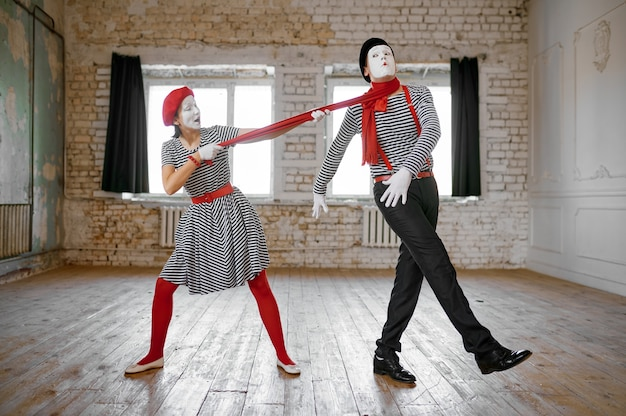 Male and female mime artists, strangulation with a scarf parody scene, comedy