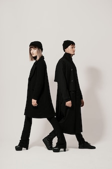 Male and female walking in different directions