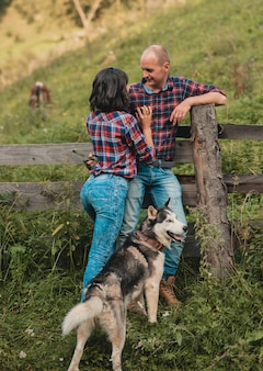 Male female with husky dog having fun on summer vacation.