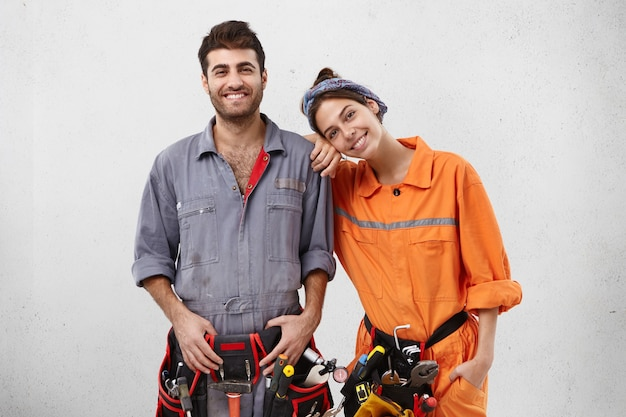 Male and female workers wearing work clothes