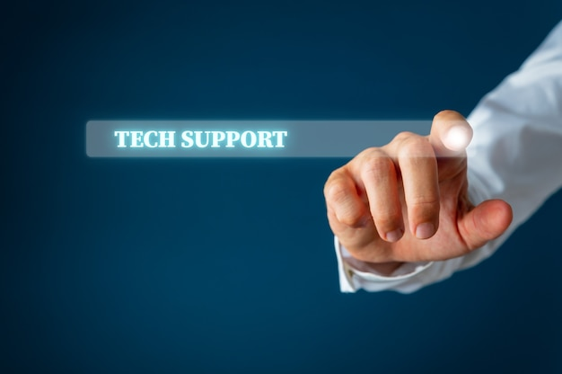 Male finger pointing at a search bar on virtual interface with tech support words in it.