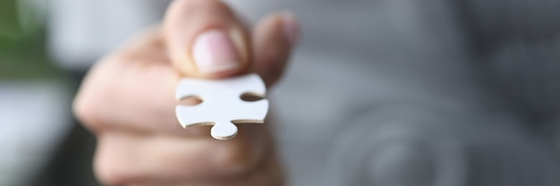 Male fingers are holding one white puzzle selection of business development