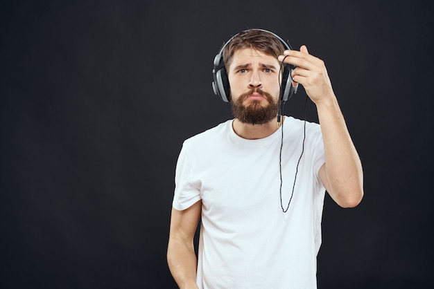 Male gamer playing a console with joysticks in headphones