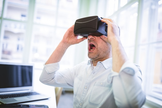 Male graphic designer using virtual reality headset
