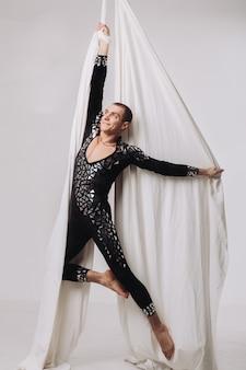 Male gymnast doing aerial silk acrobatics