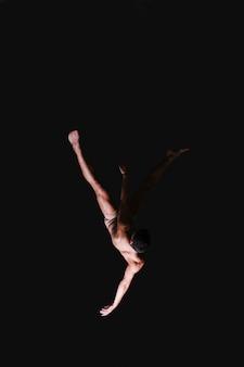 Male gymnast performing in air