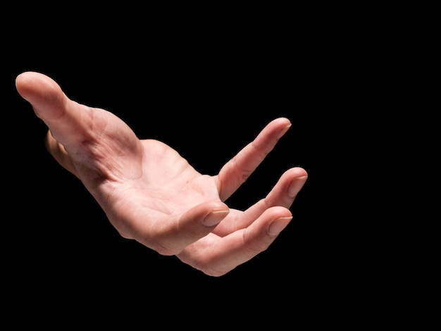 Male hand on a black background.