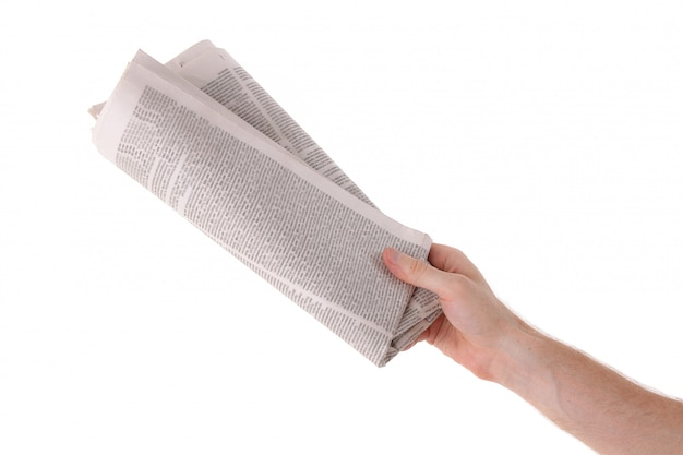 Male hand give newspaper isolated on white