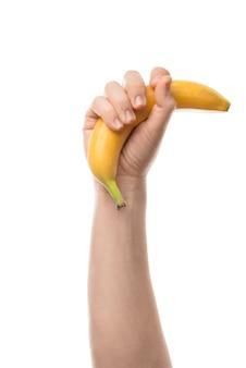 Мужская рука банана. изолированные на белом фоне.