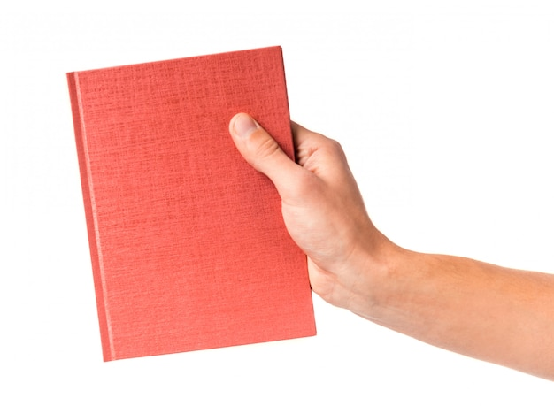 Male hand holding a book isolated