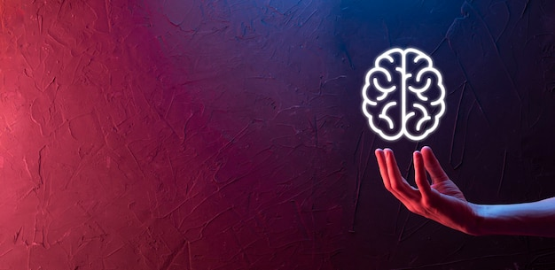 Male hand holding brain icon on neon red,blue background. artificial intelligence machine learning business internet technology concept.banner with copy space