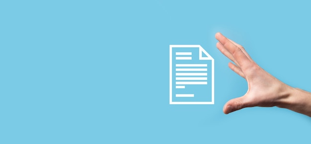 Male hand holding a document icon on blue surface