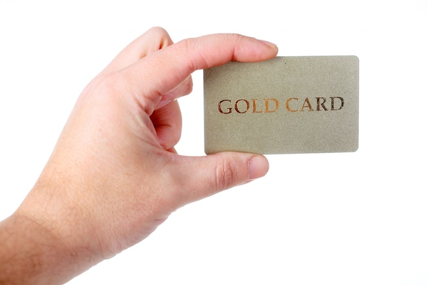 Male hand holding gold card