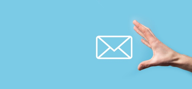 Male hand holding letter icon,email icons .contact us by newsletter email and protect your personal information from spam mail. customer service call center contact us.email marketing and newsletter.