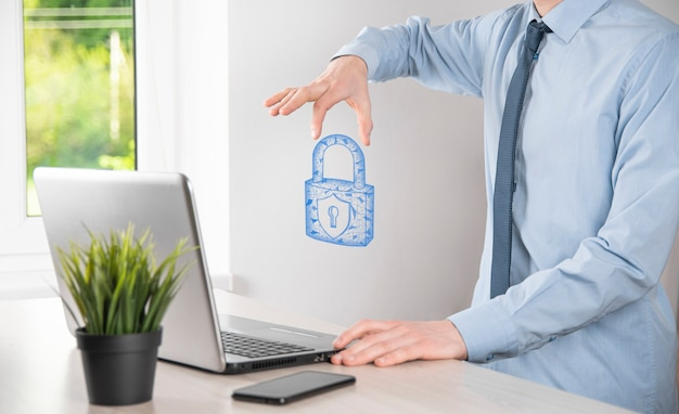 Male hand holding a lock padlock icon.cyber security network. internet technology networking.protecting data personal information on tablet. data protection privacy concept. gdpr. eu.banner