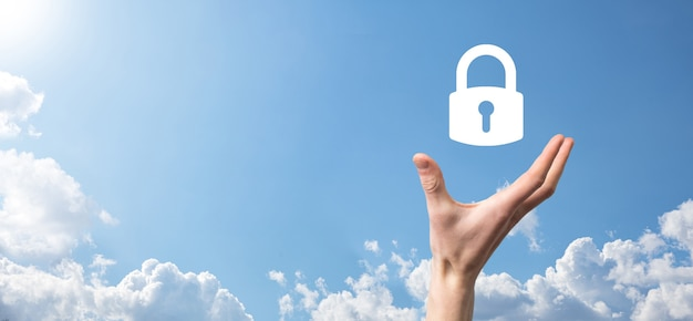 Male hand holding a lock padlock icon.cyber security network.