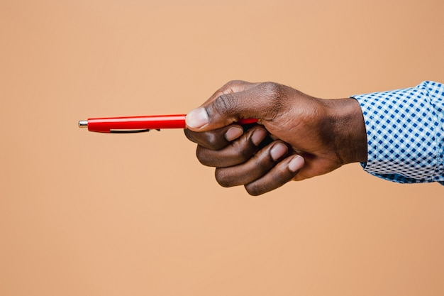 Male hand holding pencil, isolated