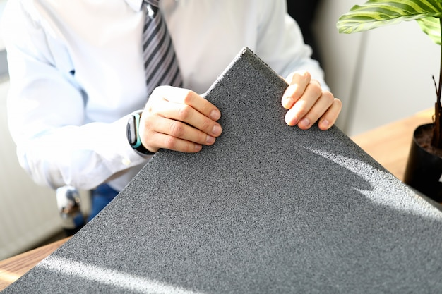 Male hand holding rubber mat