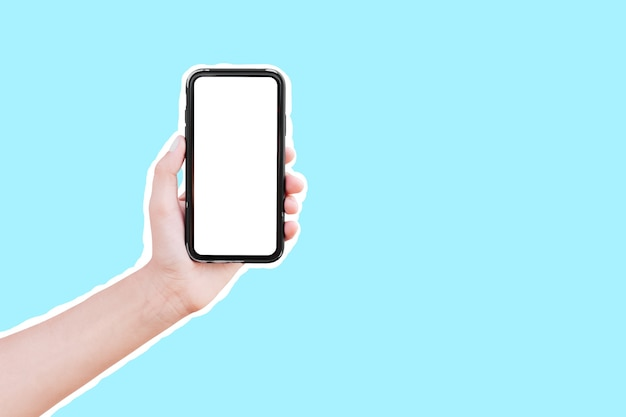 Male hand holding smartphone with mockup, isolated with white contour on blue.