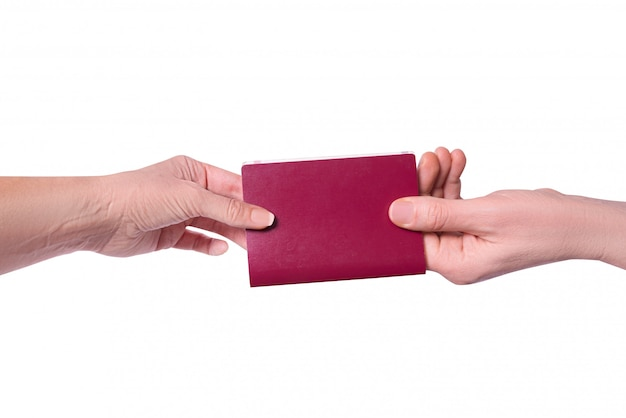 Male hand passes a passport to a woman