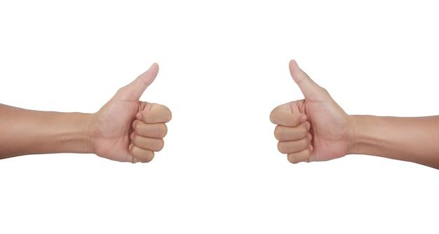 親指を立てる男性の手は反対のサインを示しています