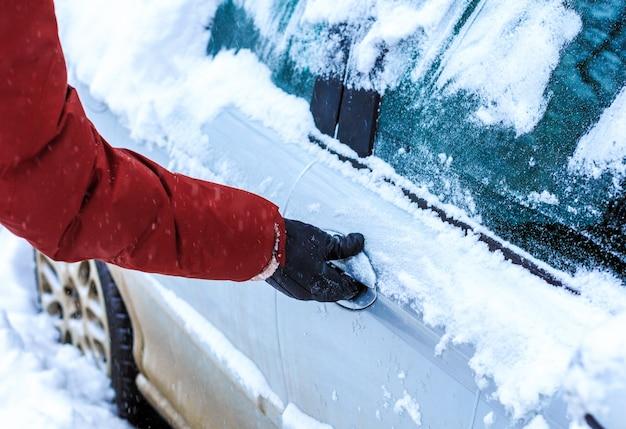 Male hand unlocking frozen car lock