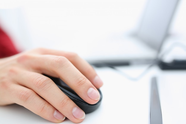 Male hand used computer mose holding in arm
