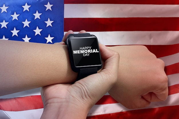 Male hand with smartwatch with text happy memorial day