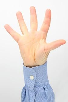 白で指を広げた男性の手