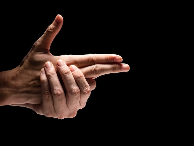 Male hands on a black background. free space for text