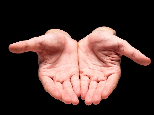 Male hands on a black background.