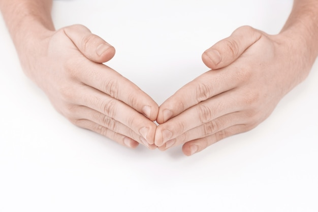 각도의 형태로 남성 손. 흰색 배경에 고립