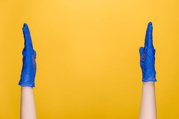 Male hands in medical gloves showing big size gesture