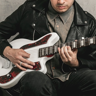 Male hands playing beautiful vintage guitar