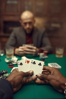 Male hands with cards, poker player in suit