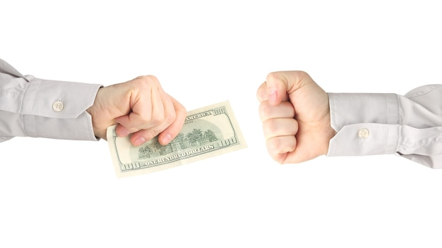Male hands with money in front of a fist isolated