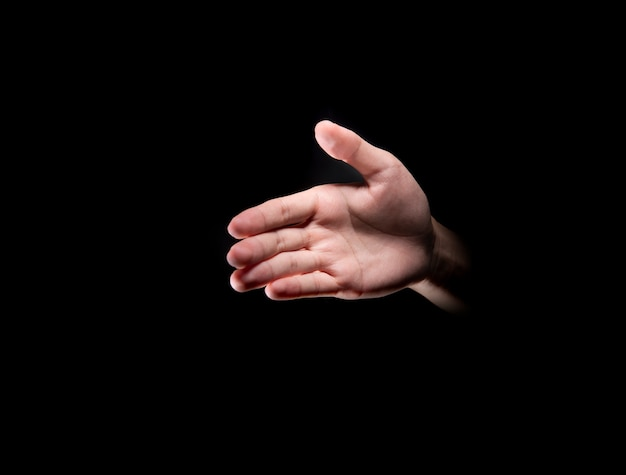 Male hands with open palm offer to handshake