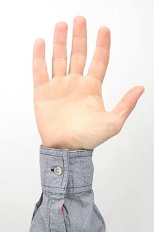 흰색 표면에 제기 손가락으로 남성 손