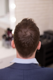 Male head with stylish haircut on barbershop
