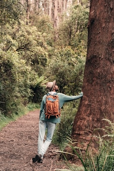 A male hiker enjoying his holidays doing a trekking in the forest.