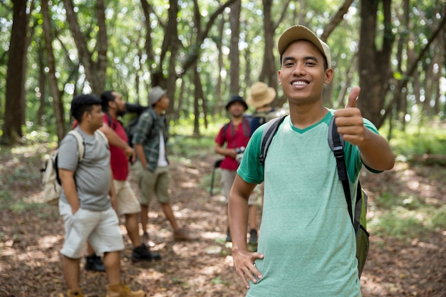 Male hiker thumb up